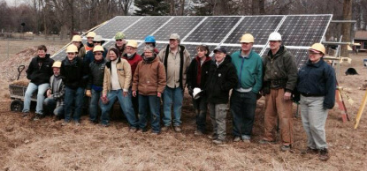 People involved in Clintonville Energy Co-op posing by solar panels