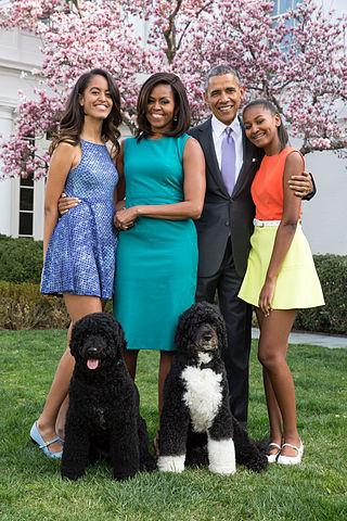 The Obama family posing outside