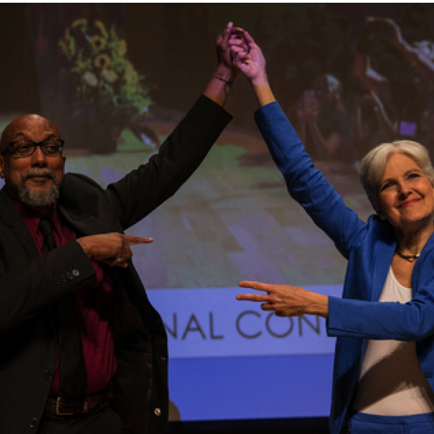 Ajamu and Jill holding up their hands in victory
