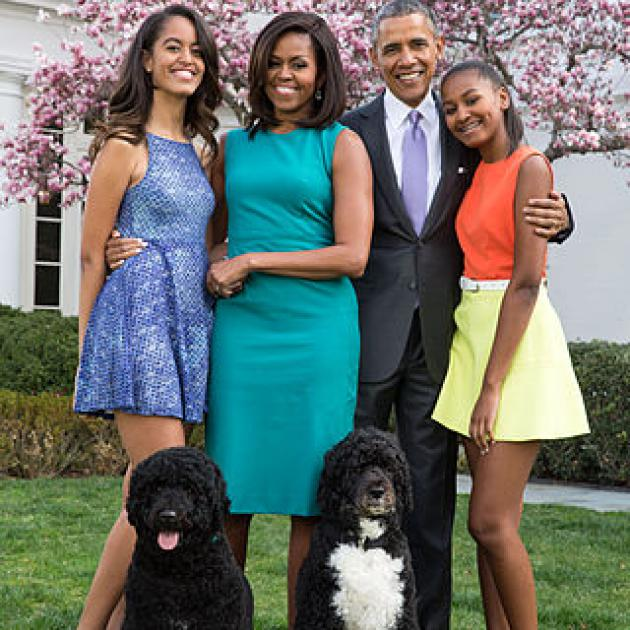 The Obama family posing outside