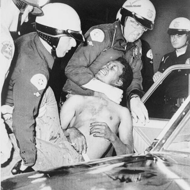 Police strangling a black man at Watts riot
