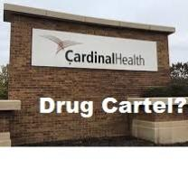 Brick sign outside with words Cardinal Health and words superimposed over picture in white below saying Drug Cartel?