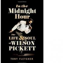 Book cover, black bakground, photo of black man bending over with a mic to his mouth singing and arm swinging backwards and the words In the Midnight Hour the life & soul of Wilson Pickett by Tony Fletcher