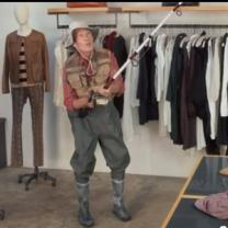 Person in a clothes store with fishing rod