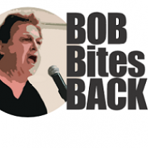 White middle aged man with black hair yelling into a microphone and words Bob Bites Back