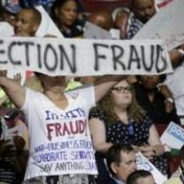 Bernie delegates holding up Election Fraud sign at DNC