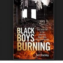 A wrecked up burning building book cover with words Black Boys Burning