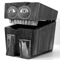 Big box with lid open and two eyes and teeth like a face