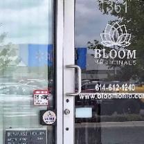 Glass front door of business with words Bloom Medicinals