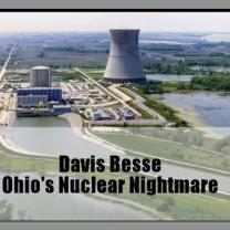 A large conical shaped cement building with other little buildings around and river of water leading to it with the words Davis Besse Ohi's Nuclear Nightmare