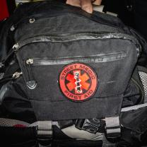 Black medic bag with red First Aid symbol on it