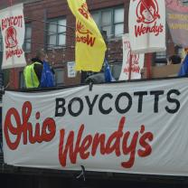 Big truck with signs to Boycott Wendy's at start of march down High Street