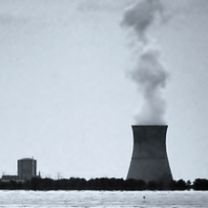 Nuke plant on the water with smoke