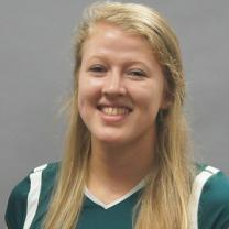 Young woman with long blonde hair in a green sports jersey