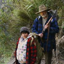 Man and young boy hiking on mountain