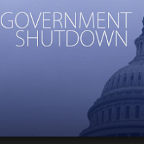 Top side of a capitol building and words Government Shutdown