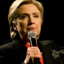 Hillary Clinton talking into a mic