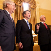 Three white guys in suits looking important
