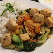 Tofu with grilled vegetables, and macadamia nuts.