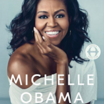 Pretty black woman smiling with long black hair waving in the wind wearing a white shirt that is off one shoulder and words Becoming at top and MIchelle Obama below