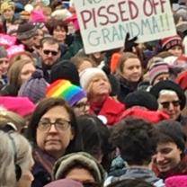 A crowd of mostly women and a sign reading Pissed Off Grandma!