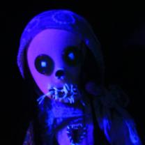 Creepy doll head in blue light