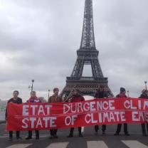 Eiffel Tower with big climate justice sign in front