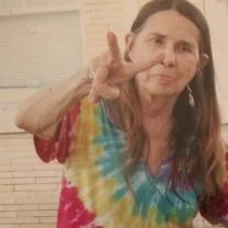 Margaret Sarber making a peace sign