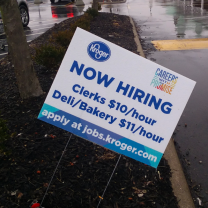 Yard sign saying Kroger is hiring people at $10 and $11 dollars an hour