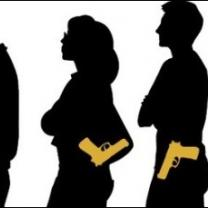 Silhouettes of people all carrying guns