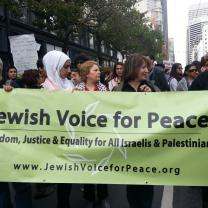 People holding a Jewish Vices for Peace banner