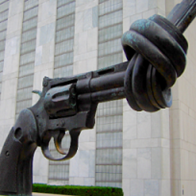Statue of large gun with a knot at the end so a bullet couldn't come out